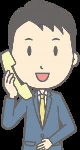 電話を受ける引越し業者の営業員